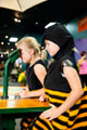 Girls in bee  costumes in Backyard Adventures. Credit: Imagine Exhibitions, Inc.