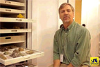 Dr. Ted Daeschler in front of the Mineralogy Collection