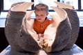 boy with giant clam shell