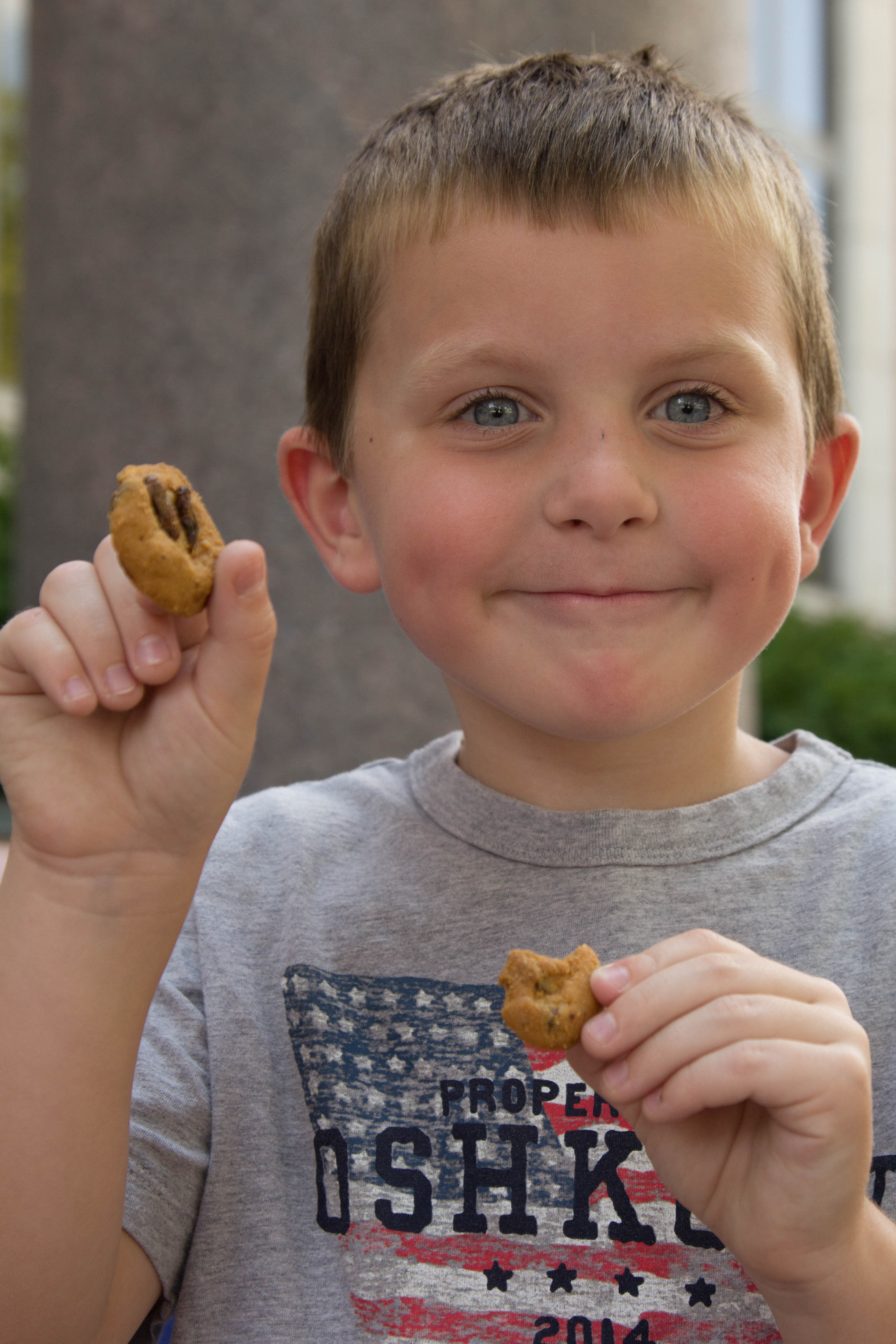 boy holding cookie. By Meredith Dolan/ANS