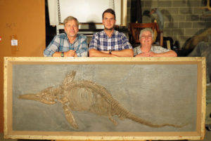 3 scientists with fossil