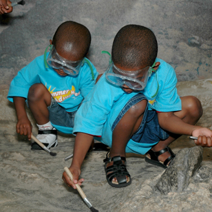 two boys digging for dinosaurs in The Big Dig