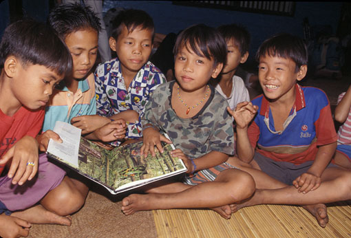 boys in Borneo reading a book