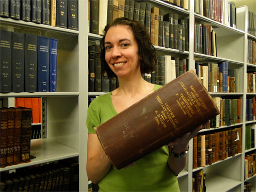 photo of librarian holding Cope's publication