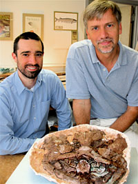 Jason Downs and Ted Daeschler pose behind the fossil Laccagnathus