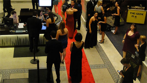 people walking on the red carpet leading into Geekadelphia