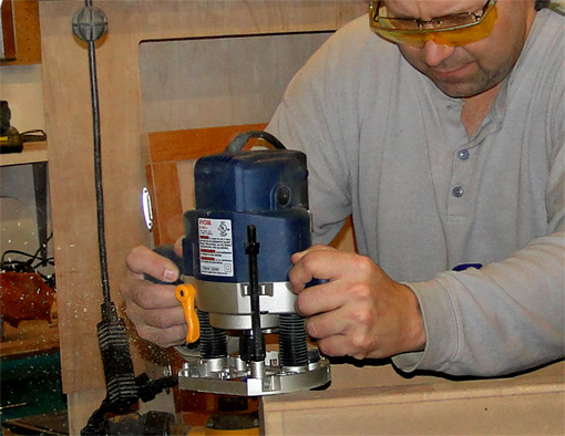 photo of a woodworker using a router