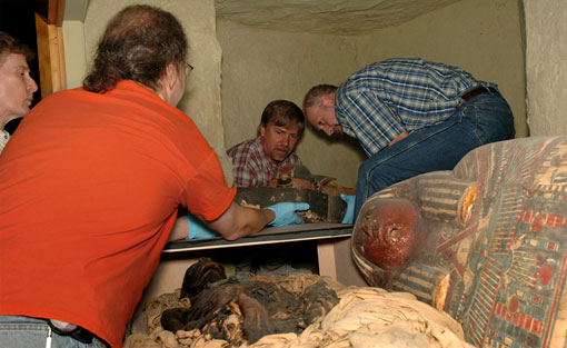 photo of Academy staff removing the mummy from the diorama