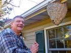 Paul Kiry next to the hornet nest at his home