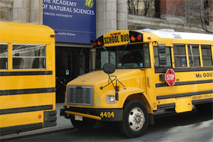 two school buses outside the Academy's entrance