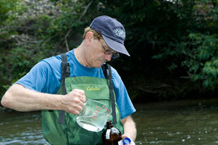 environmental chemist taking water quality samples