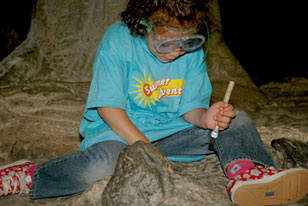 girl digging for fossils in The Big Dig